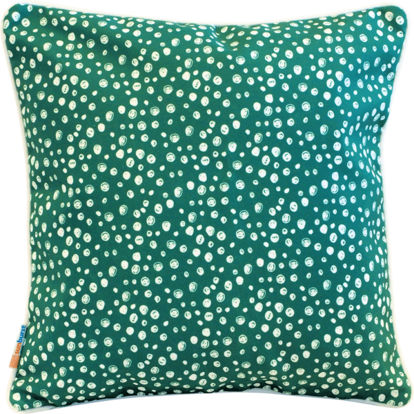 green and white spotted cushion
