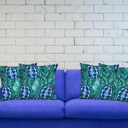 leafy designer cushion on blue couch