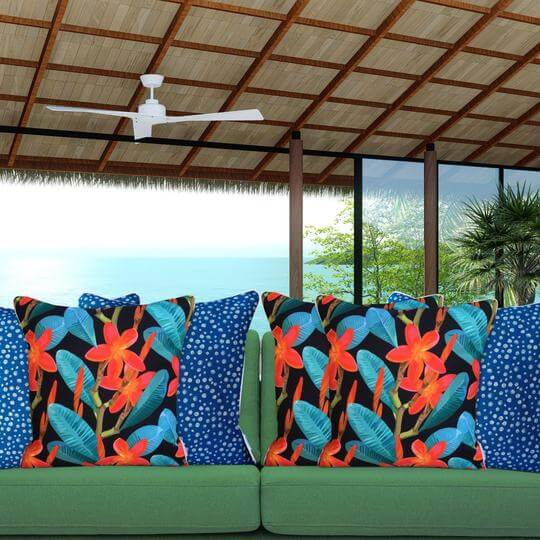 red tropical flowers on black background designer outdoor cushion blue mix
