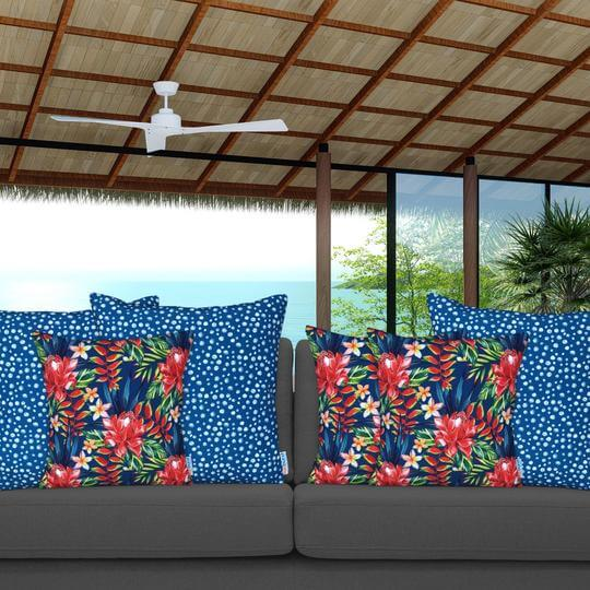 blue and white spotted cushion with flowers