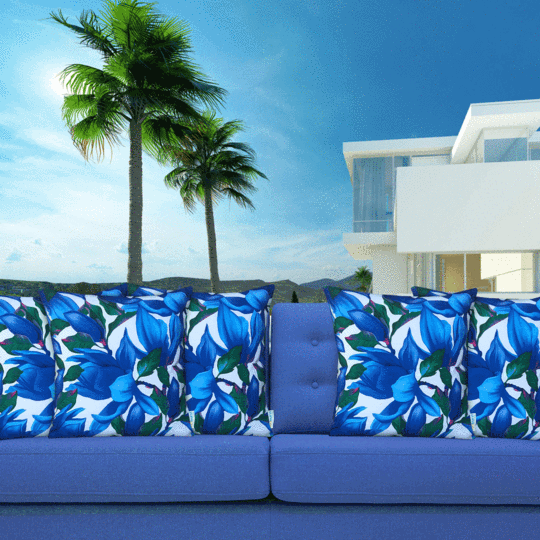 blue and white designer outdoor cushion on blue couch